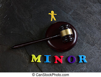 Juvenile court system - Gavel with Minor spelled out in play...