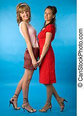 két, young women