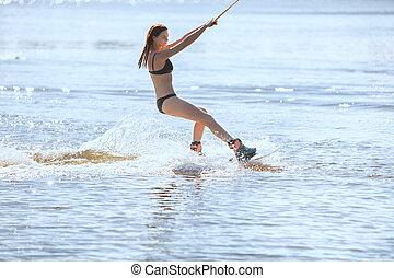 kąpanie się, kobieta, wakeboarding., idzie, garnitur