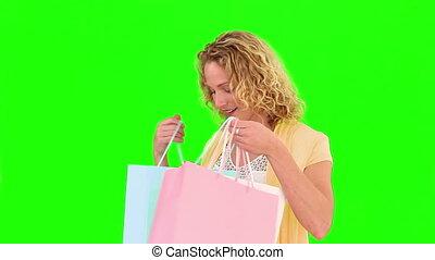 kędzierzawy, blond, haired, kobieta, holind, shopping torby