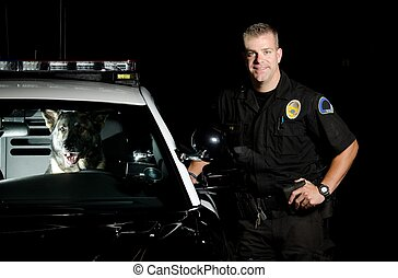 a k9 officer standing next to his patrol car with his partner in the driver seat.