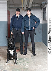 K9 squad police officers - Portrait of two young police...