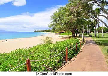 Kaanapali beach boardwalk on the West Maui coast line.