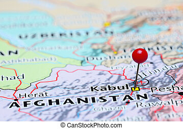Photo of pinned Kabul on a map of Asia. May be used as illustration for traveling theme.