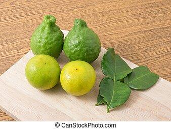Kaffir Lime with Lemon Lime on A Cutting Board