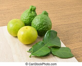 Kaffir Lime with Lemon Lime on Wooden Board