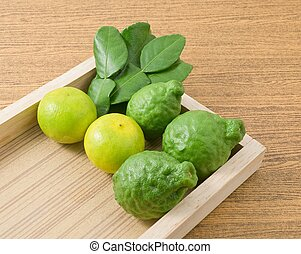 Kaffir Lime with Lemon Lime on Wooden Tray
