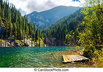 Kaindy Lake in Tien Shan mountain, Kazakhstan. Autumn