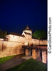 Kaiserburg wall and bridge at night in  Nuremberg