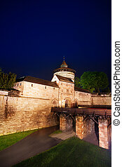 Kaiserburg wall and bridge at night in  Nuremberg