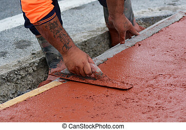 Road work - KAITAIA, NZ JAN 23:Road worker use finishing ...