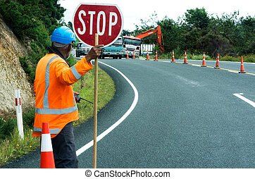 Road work - KAITAIA, NZ - NOV 05:Road worker slows traffic ...