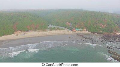 Kalacha beach on sunset. India in Goa. Aerial
