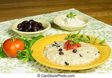 Kalamata olive risotto with tomatoes and herbs