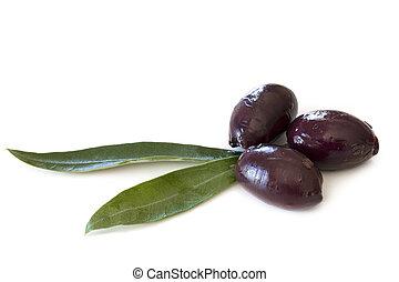 Black kalamata olives with olive leaves, isolated on white.