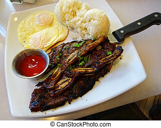 Kalbi steak ribs with two eggs over easy, two scoops of rice...