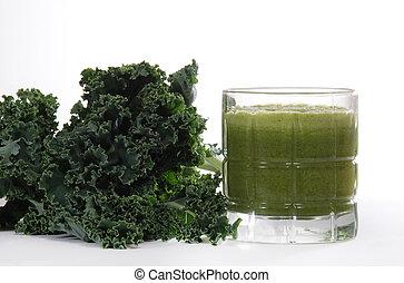 Kale and juice - Fresh kale leaves near juiced kale beverage...
