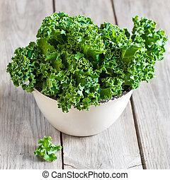 Kale - Fresh green kale in ceramic bowl. Selective focus.