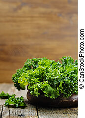 kale salad on a wood background. tinting. selective focus