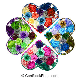 Kaleidoscope Design made from hearts formed from artificial flowers and beads (ladies barrettes) isolated on white background