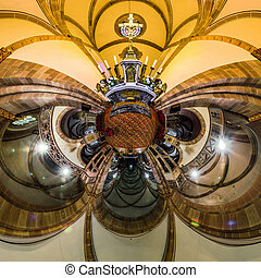 Kaleidoscope view of gothic church interior, little planet effect of panoramic shot. Andlau, France.