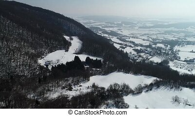Kalnik mountain hills under snow winter aerial footage, Prigorje region of Croatia