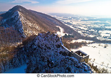Kalnik mountain winter aerial view, fortress on cliff,...