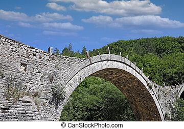 Kalogeriko arched stone bridge Zagoria Greece summer season