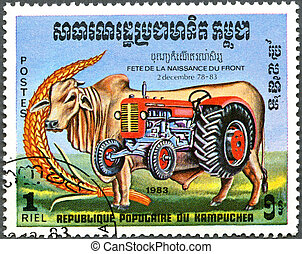 KAMPUCHEA - CIRCA 1983: A stamp printed by Kampuchea shows bull and tractor, series devoted to Festival of Rebirth, circa 1983