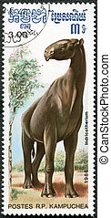 KAMPUCHEA - CIRCA 1986: A stamp printed by Kampuchea shows Indricotherium, series devoted to prehistoric animals, circa 1986