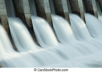 Close up time exposure of the spillway on the Kananaskis hydroelectric dam on the Bow River, Alberta, Canada
