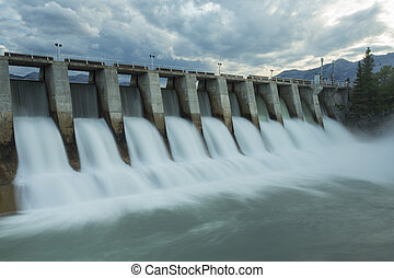 Wide shot time exposure of the spillway on the Kananaskis hydroelectric dam on the Bow River, Alberta, Canada