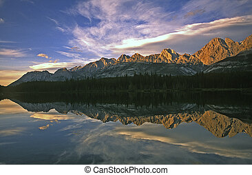 After spending much of the day in the Spray Lakes Valley we found ourselves approaching the Kananaskis at sunset to be greeted by this amazing sight. As the last rays touched the peaks we got a perfect reflection thanks to a perfectly calm pond.
