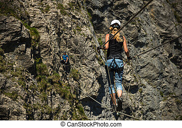 Kandersteg - amazing vacation destination in the Swiss Alps, Switzerland. Couple on a lovely via ferrata