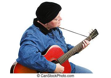 kanker, overlevende, spelende guitar