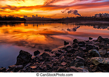 A horizontal image of Kansas City, Missouri taken from KAW point at where the Missouri and the KAW River comes together.