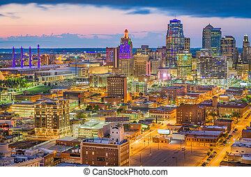 Kansas City, Missouri, USA downtown cityscape at twilight.