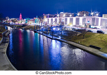 A view of the Kansas City Country Club Plaza Christmas lights and the skyline of downtown Kansas City, Missouri
