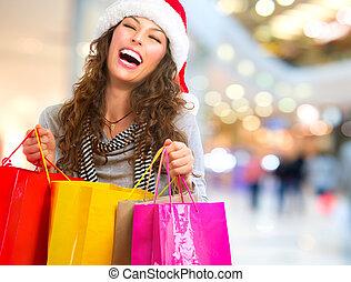 karácsony, shopping., nő, noha, pantalló, alatt, bevásárlás,...