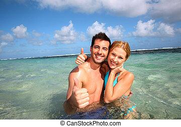 karaibski, para, do góry, kciuki, laguna, pokaz