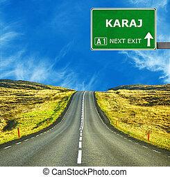 KARAJ road sign against clear blue sky