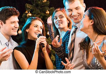 Karaoke party - Portrait of five friends having fun at...