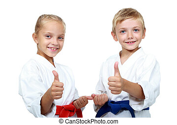 Karate athletes show a show thumbs - Children athletes with...