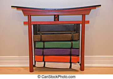 Karate Belts - A display of degrees of karate belts in a...