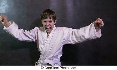 Karate boy kid screaming success teenager victory rejoices -...