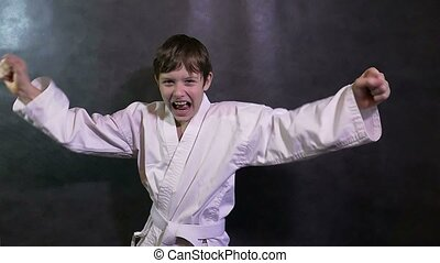 Karate boy kid screaming success teenager victory rejoices -...