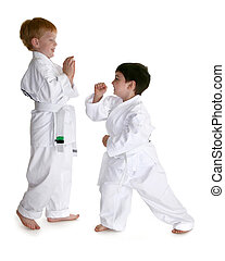 Karate Buddies - Two four year old boys sparring and...