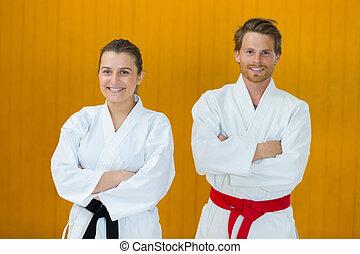 karate couple looking at camera