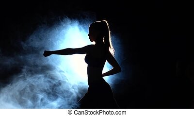 Karate demonstration performance girl. Black. Silhouette....