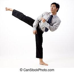 Karate Kick - A young asian businessman does a high karate...